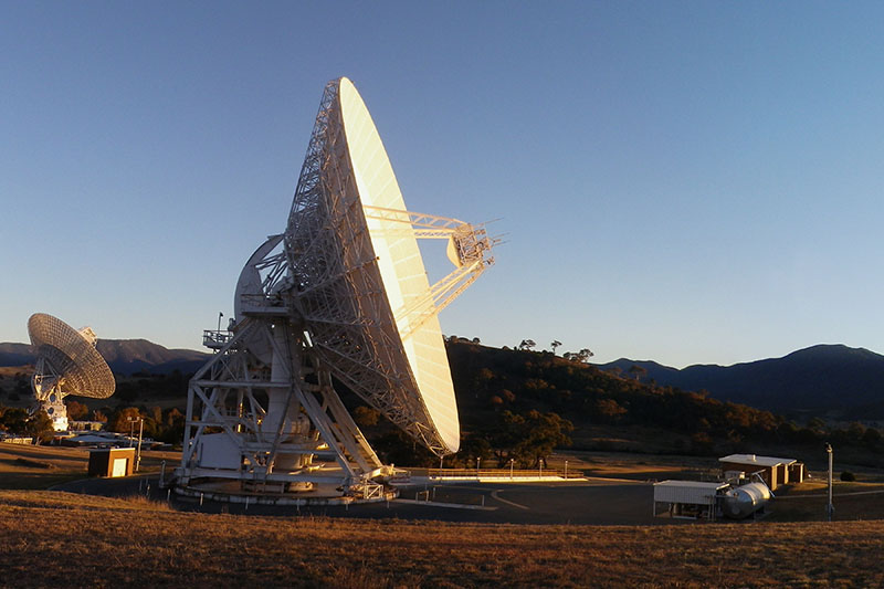 Side on view of DSS34 with DSS43 in the background on the left and hills behind