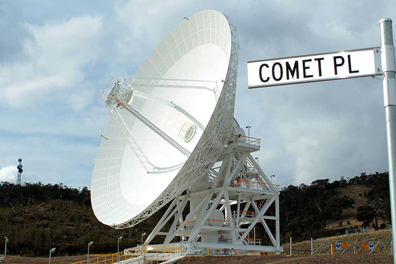 DSS35 on a big angle facing left, showing quadropod legs, with a 'Comet Place' street sign on the right