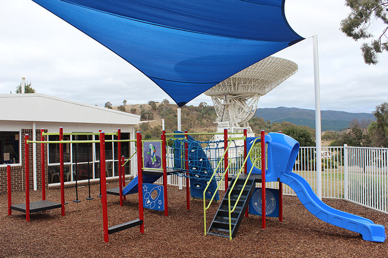 Children's playground covered by a shade sail