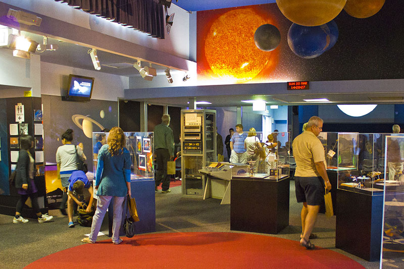 Inside the visitor centre, showing people and exhibits